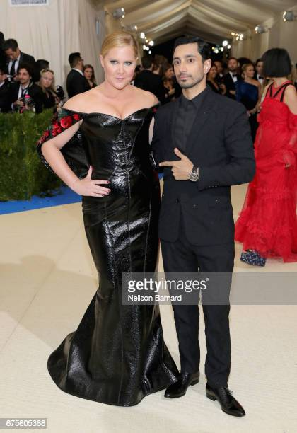 Ashley Schumer and Riz Ahmed attend the 'Rei Kawakubo/Comme des Garcons Art Of The InBetween' Costume Institute Gala at Metropolitan Museum of Art on...