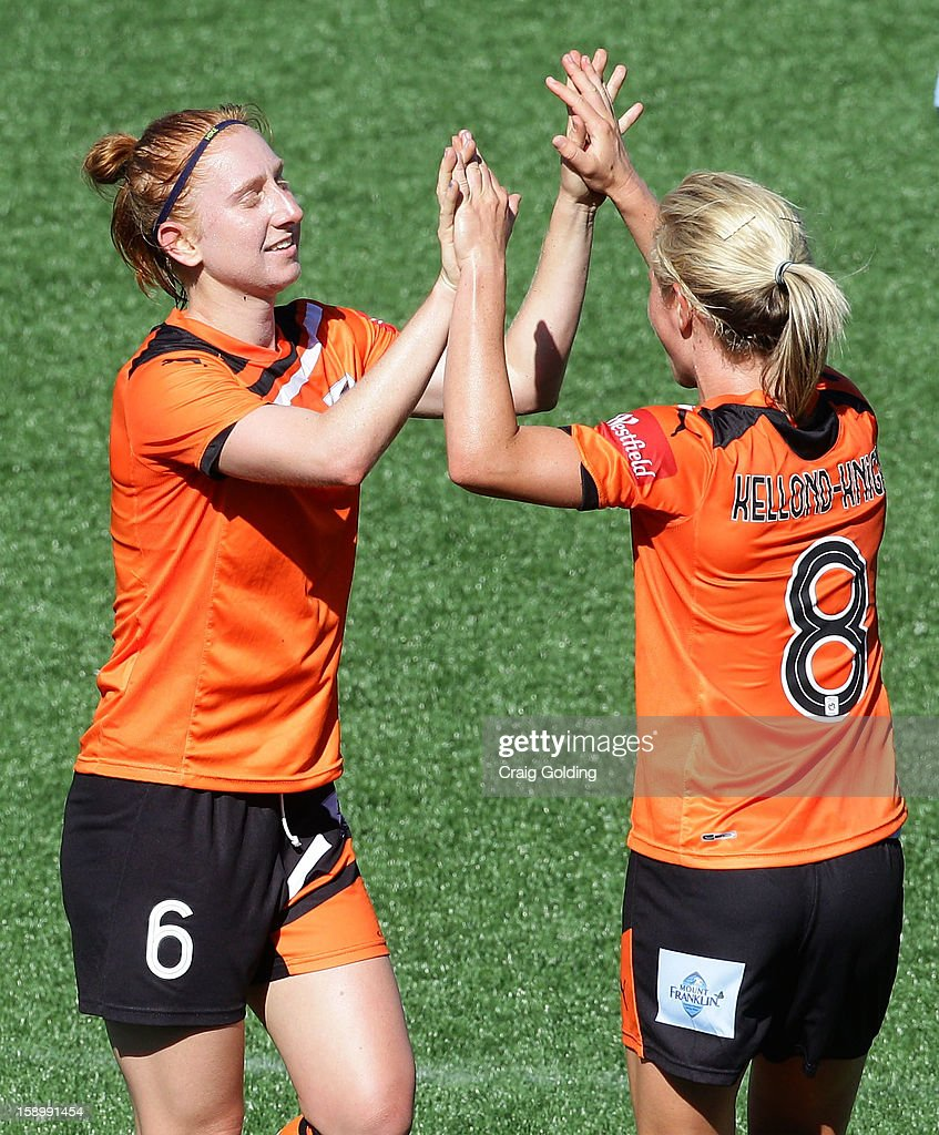 Ashley Spina and Elise Kellond-Knight of the Roar celebrate at full time of the round 11 W-League match between Sydney FC and the Brisbane Roar on January 5, 2013 in Sydney, Australia.