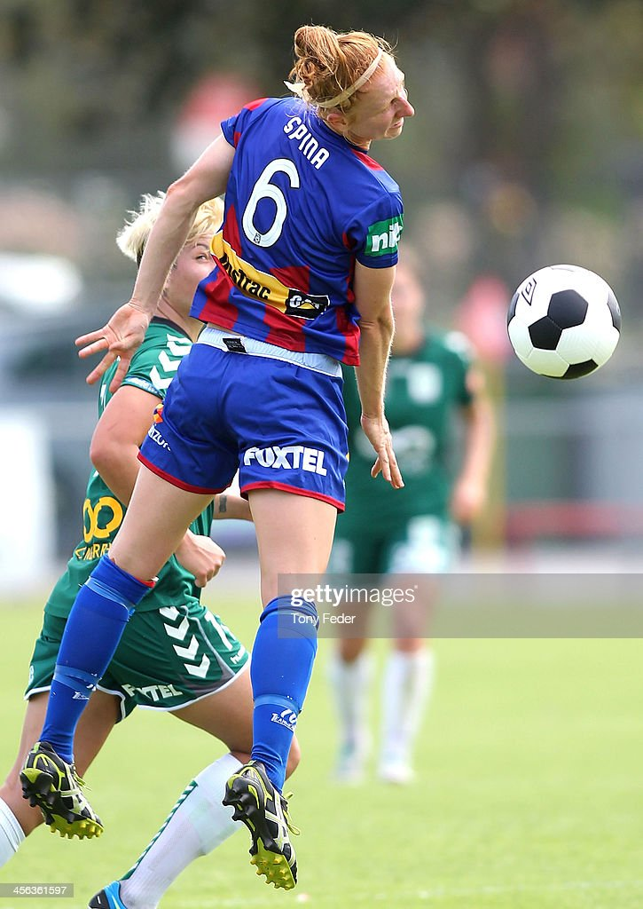 Ashley Spina of the Jets heads the ball during the round five W-League match between the Newcastle Jets and Canberra United at Wanderers Oval on December 14, 2013 in Newcastle, Australia.