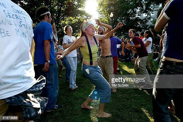 Ashley Stephens from Marlboro Vermont dances in a park several blocks from the IMF and World Band Buildings as antiglobalization protesters...