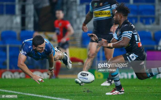 Ashley Taylor of the Titans scores a try during the round 19 NRL match between the Gold Coast Titans and the Cronulla Sharks at Cbus Super Stadium on...