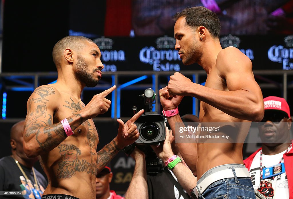 Ashley Theophane (left) and Angino Perez (right) face off after weighing in for their welterweight fight at the MGM Grand Garden Arena on May 2, 2014 in Las Vegas, Nevada.