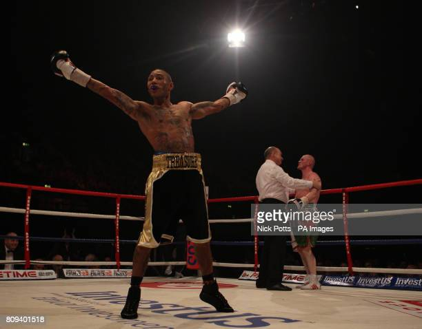 Ashley Theophane celebrates retaining his British Light Welterweight title after stopping Wales' Jason Cook in the 10th round during the British...