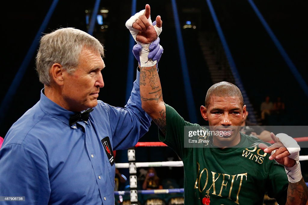 Ashley Theophane has his arm lifted by referee Jay Nady after defeating Steven Upsher in their junior welterweight fight at MGM Grand Garden Arena on...
