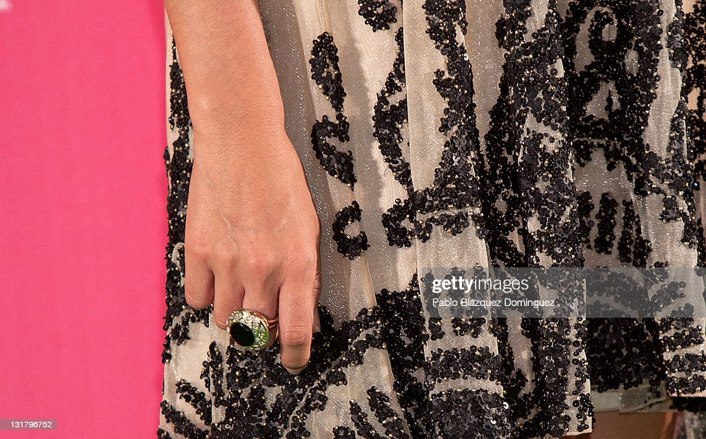 <a gi-track='captionPersonalityLinkClicked' href=/galleries/search?phrase=Ashley+Tisdale&family=editorial&specificpeople=213972 ng-click='$event.stopPropagation()'>Ashley Tisdale</a> 'ring detail' attends 'Sharpay's Fabulous Adventure' photocall at Disney Channel on May 23, 2011 in Madrid, Spain.