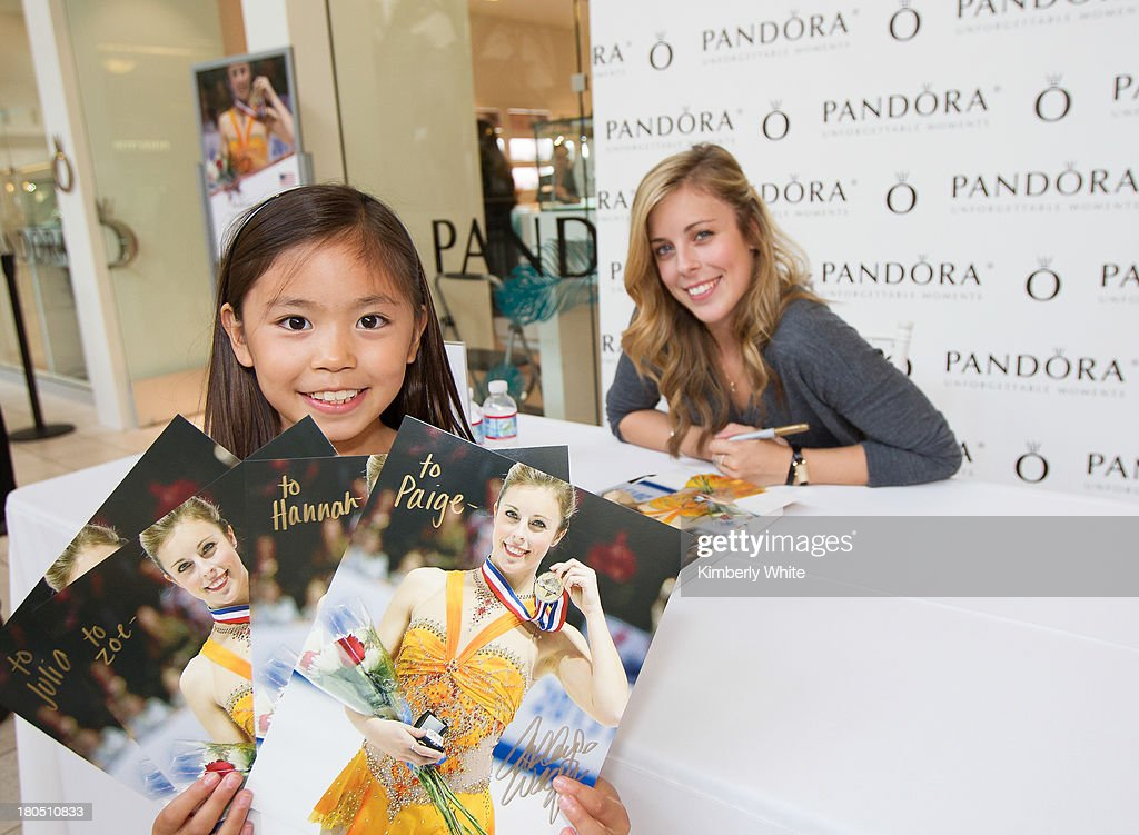 <a gi-track='captionPersonalityLinkClicked' href=/galleries/search?phrase=Ashley+Wagner&family=editorial&specificpeople=2564533 ng-click='$event.stopPropagation()'>Ashley Wagner</a>, Two-time U.S. figure skating champion (R) sits at a table behind a fan holding signed pictures at PANDORA at Hillsdale on September 13, 2013 in San Mateo, California.