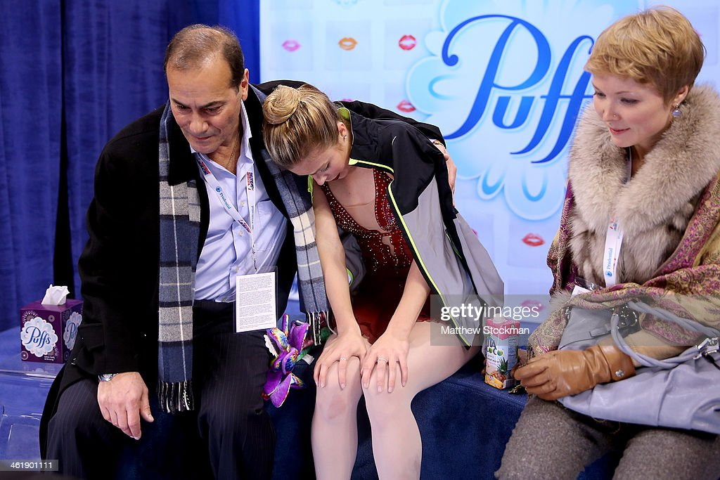 <a gi-track='captionPersonalityLinkClicked' href=/galleries/search?phrase=Ashley+Wagner&family=editorial&specificpeople=2564533 ng-click='$event.stopPropagation()'>Ashley Wagner</a>, with her coaches Rafael Arutyunyan and Nadia Kanaeva, waits for her scores in the kiss and cry after skating in the ladies free skate during the Prudential U.S. Figure Skating Championships at TD Garden on January 11, 2014 in Boston, Massachusetts.
