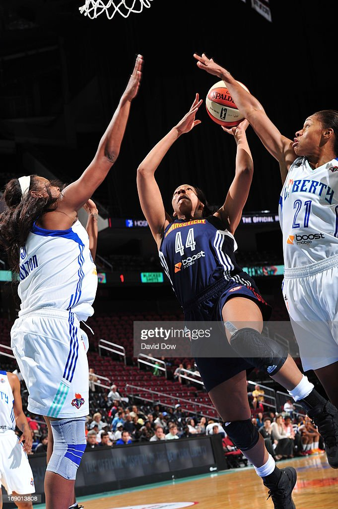 Ashley Walker #44 of the Connecticut Sun shoots against Alex Montgomery #21 of the New York Liberty during the WNBA game on May 18, 2013 at the Prudential Center in Newark, New Jersey.