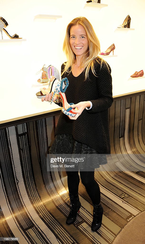 Ashley Warwa attends a Christmas drinks hosted by designer Nicholas Kirkwood to celebrate his partnership with Chambord black raspberry liquer, and launch the limited edition shoe 'The Chambord' at the Nicholas Kirkwood Mount Street store on December 12, 2012 in London, England.