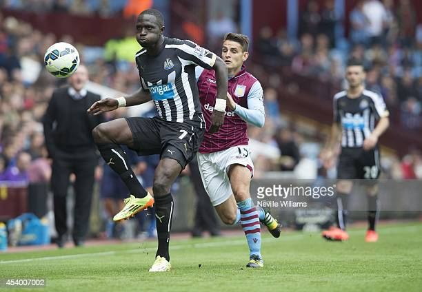 Ashley Westwood of Aston Villa challenges Moussa Sissoko of Newcastle United during the Barclays Premier League match between Aston Villa and...