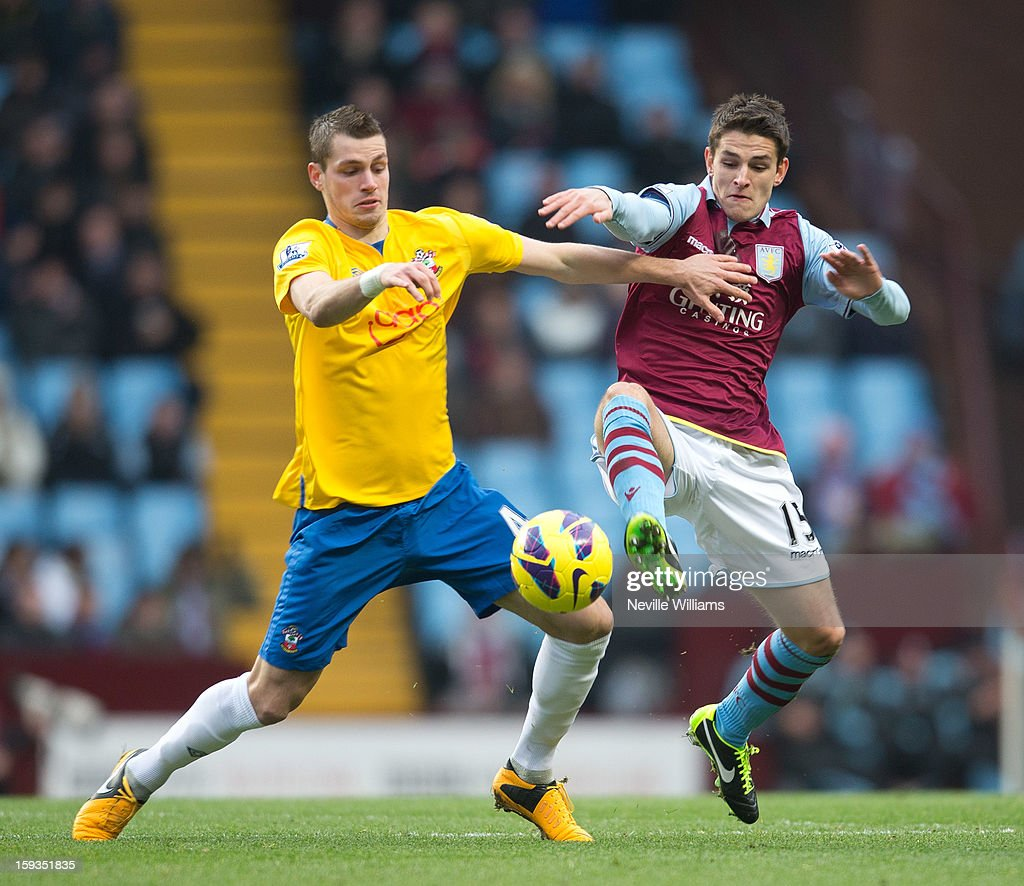 Ashley Westwood of Aston Villa is challenged by <a gi-track='captionPersonalityLinkClicked' href=/galleries/search?phrase=Morgan+Schneiderlin&family=editorial&specificpeople=4191360 ng-click='$event.stopPropagation()'>Morgan Schneiderlin</a> of Southampton during the Barclays Premier League match between Aston Villa and Southampton at Villa Park on January 12, 2013 in Birmingham, England.
