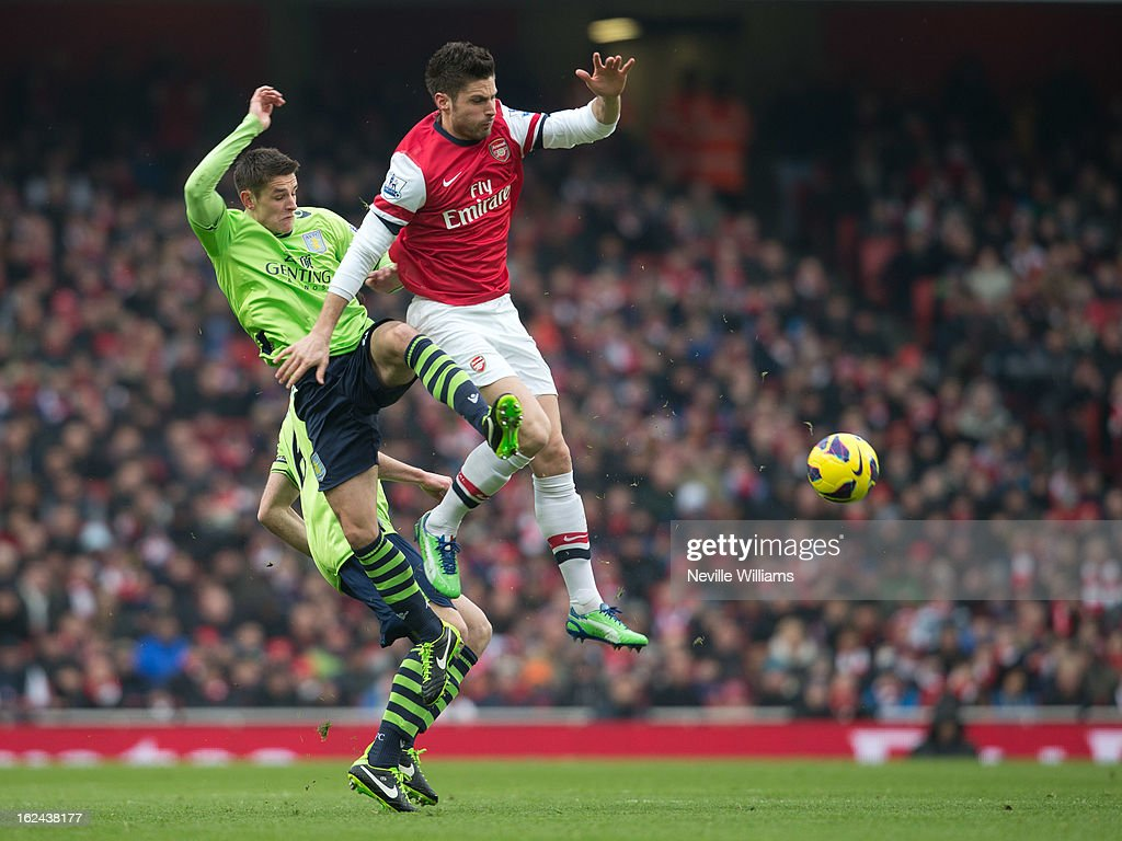 Ashley Westwood of Aston Villa is challenged by Oliver Giroud of Arsenal during the Barclays Premier League match between Arsenal and Aston Villa at Emirates Stadium on February 23, 2013 in London, England.