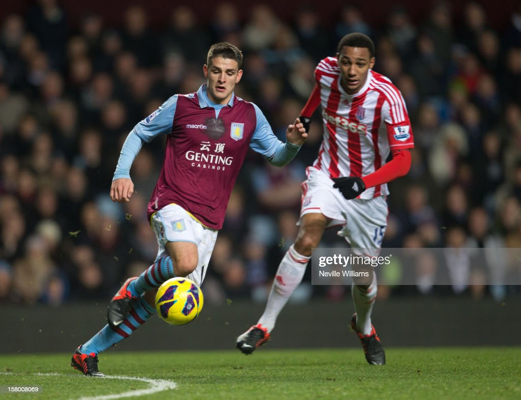 Ashley Westwood of Aston Villa is challenged by <a gi-track='captionPersonalityLinkClicked' href=/galleries/search?phrase=Steven+N%27Zonzi&family=editorial&specificpeople=6324480 ng-click='$event.stopPropagation()'>Steven N'Zonzi</a> of Stoke City during the Barclays Premier League match between Aston Villa and Stoke City at Villa Park on December 08, 2012 in Birmingham, England.