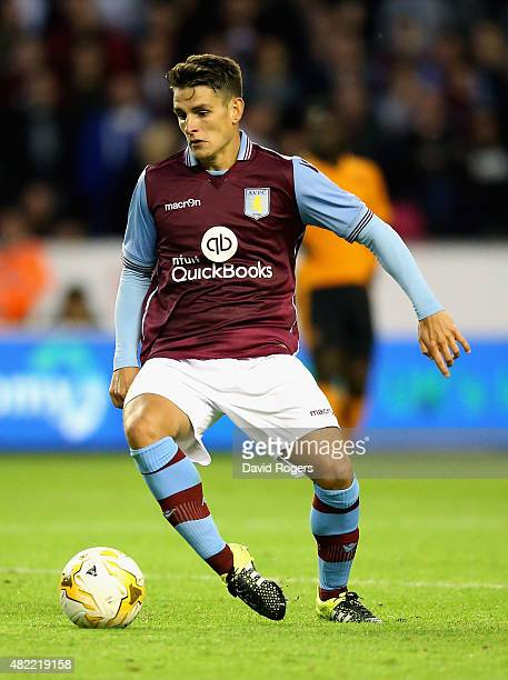 Ashley Westwood of Aston Villa runs with the ball during the pre season friendly between Wolverhampton Wanderers and Aston Villa at Molineux on July...