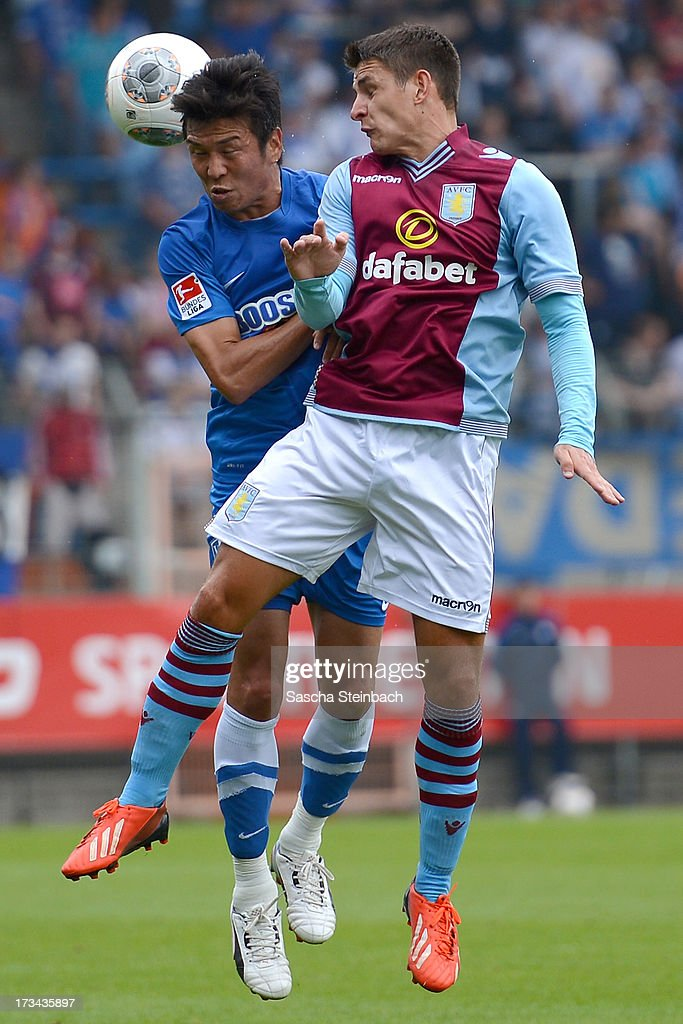 Ashley Westwood (R) of Aston Villa vies with Yusuke Tasaka (L) of Bochum during the pre-season friendly match between VfL Bochum and Aston Villa at Rewirpower Stadium on July 14, 2013 in Bochum, Germany.