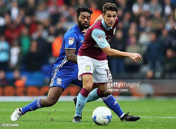 Ashley Westwood of Aston Villa wins the ball from Jacques Maghoma of Birmingham City during the Sky Bet Championship match between Birmingham City...