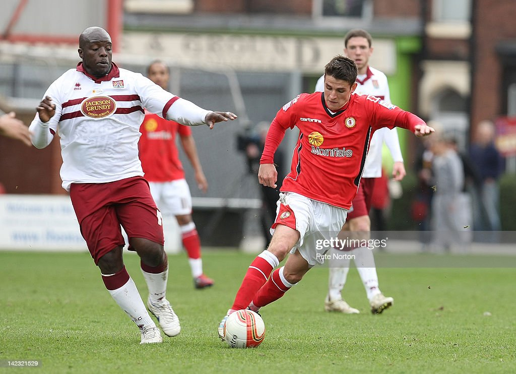Ashley Westwood of Crewe Alexandra controls the ball watched by <a gi-track='captionPersonalityLinkClicked' href=/galleries/search?phrase=Adebayo+Akinfenwa&family=editorial&specificpeople=609204 ng-click='$event.stopPropagation()'>Adebayo Akinfenwa</a> of Northampton Town during the npower League Two match between Crewe Alexandra and Northampton Town at The Alexandra Stadium on March 31, 2012 in Crewe, England.