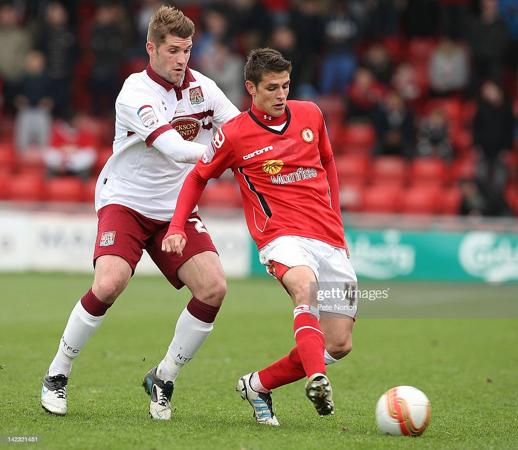 Ashley Westwood of Crewe Alexandra plays the ball under pressure from Ben Harding of Northampton Town during the npower League Two match between Crewe Alexandra and Northampton Town at The Alexandra Stadium on March 31, 2012 in Crewe, England.