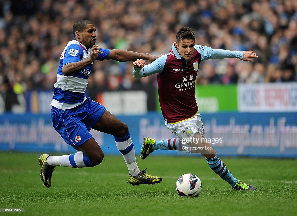 Ashley Westwood of Villa battles with Mikele Leigertwood of Reading during the Barclays Premier League match between Reading and Aston Villa at Madejski Stadium on March 9, 2013 in Reading, England.