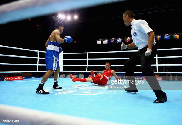 Ashley Williams competes against Devendro Liashram of India during the Men's Light Fly 4649kg SemiFinals Boxing at Scottish Exhibition And Conference...