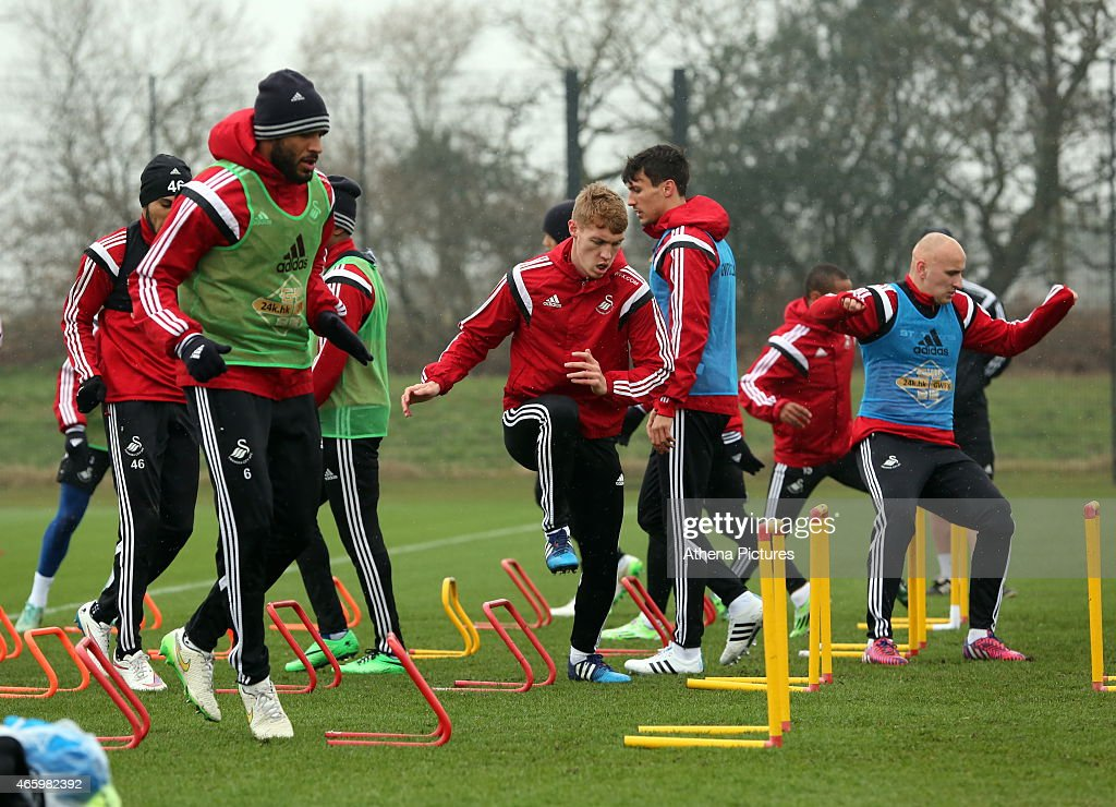Ashley Williams (L) Jay Fulton (C) and Jonjo Shelvey (R) during the Swansea City training session at Fairwood Training Ground on March 12, 2015 in Swansea, Wales.