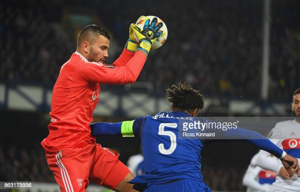 Ashley Williams of Everton challenges goalkeeper Anthony Lopes of Lyon during the UEFA Europa League Group E match between Everton FC and Olympique...