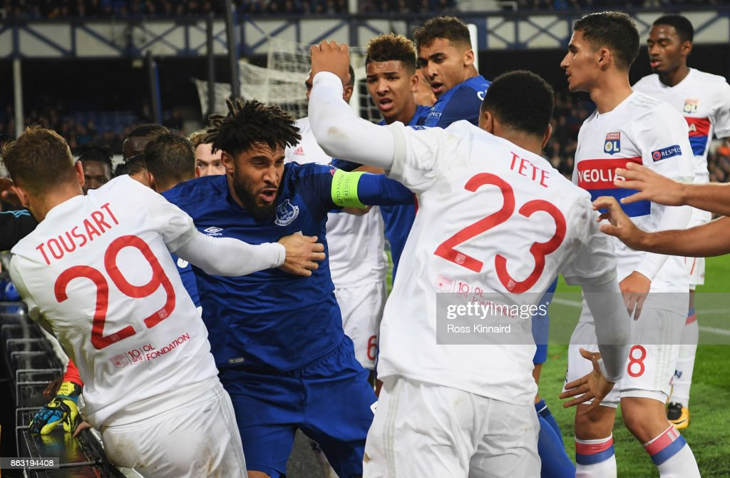 Ashley Williams of Everton (2L) clashes with Lyon players after a challenge on Anthony Lopes of Lyon during the UEFA Europa League Group E match between Everton FC and Olympique Lyon at Goodison Park on October 19, 2017 in Liverpool, United Kingdom.