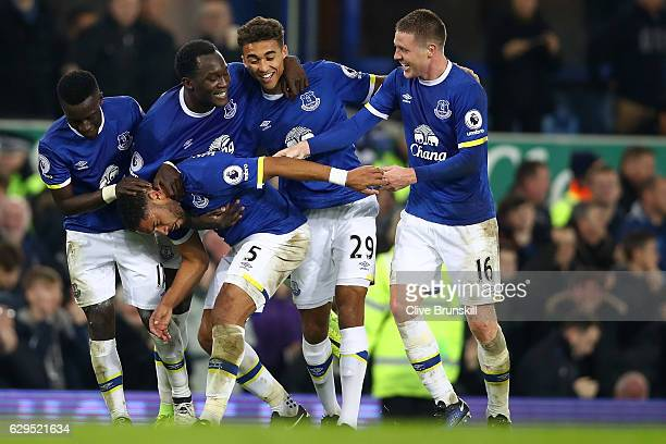 Ashley Williams of Everton is congratulated by teammates after scoring his teams second goal during the Premier League match between Everton and...