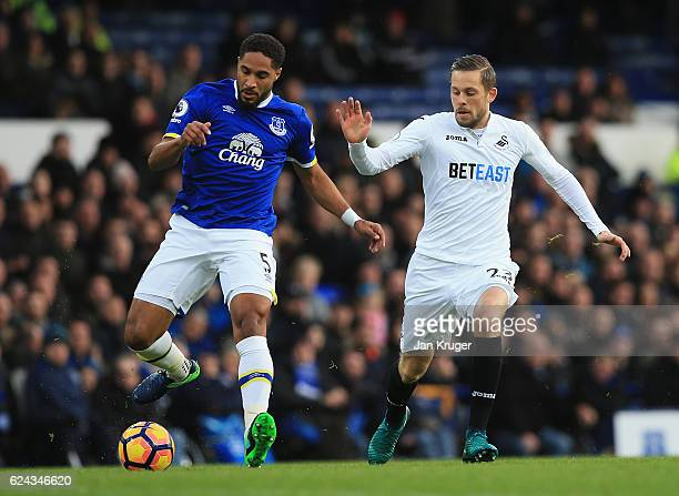 Ashley Williams of Everton is put under pressure from Gylfi Sigurdsson of Swansea City during the Premier League match between Everton and Swansea...