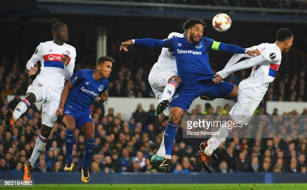 Ashley Williams of Everton jumps for the ball ahead of Kenny Tete of Lyon during the UEFA Europa League Group E match between Everton FC and...