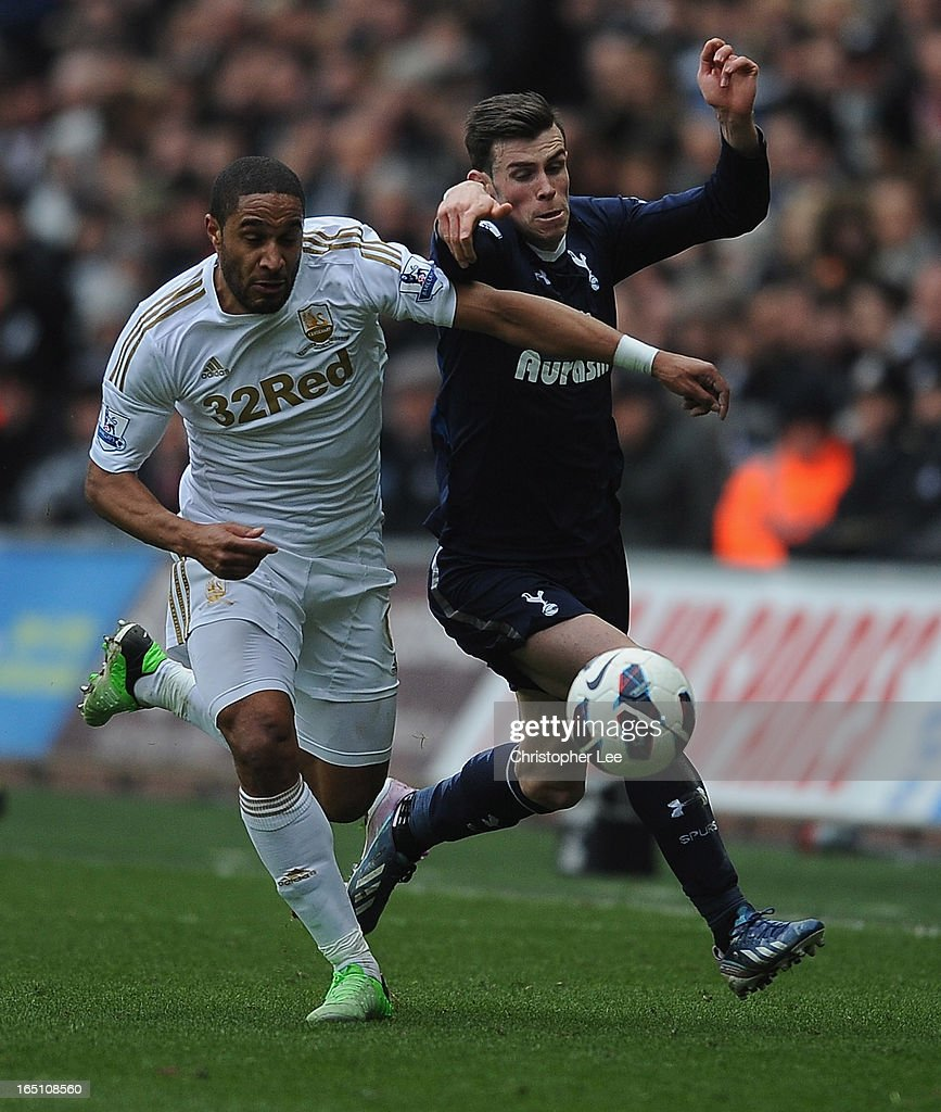 Ashley Williams of Swansea battles with <a gi-track='captionPersonalityLinkClicked' href=/galleries/search?phrase=Gareth+Bale&family=editorial&specificpeople=609290 ng-click='$event.stopPropagation()'>Gareth Bale</a> of Spurs during the Barclays Premier League match between Swansea City v Tottenham Hotspur at Liberty Stadium on March 30, 2013 in Swansea, Wales.