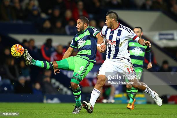 Ashley Williams of Swansea City and Salomon Rondon of West Bromwich Albion compete for the ball during the Barclays Premier League match between West...