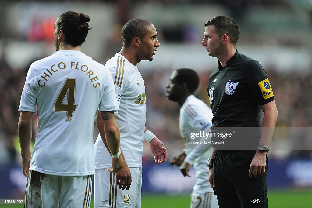 Ashley Williams of Swansea City argues with referee Michael Oliver during the Barclays Premier League match between Swansea City and Manchester United at the Liberty Stadium on December 23, 2012 in Swansea, Wales.