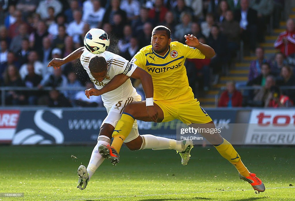 Ashley Williams of Swansea City battles for the ball with <a gi-track='captionPersonalityLinkClicked' href=/galleries/search?phrase=Adrian+Mariappa&family=editorial&specificpeople=661604 ng-click='$event.stopPropagation()'>Adrian Mariappa</a> of Reading during the Barclays Premier League match between Swansea City and Reading at the Liberty Stadium on October 6, 2012 in Swansea, Wales.