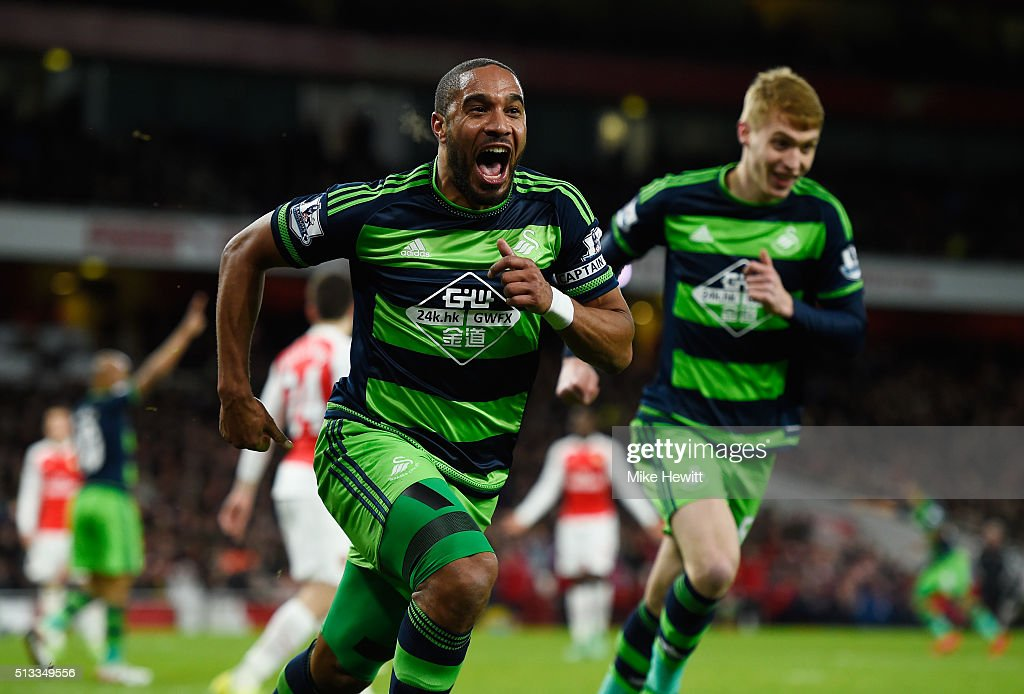 Ashley Williams of Swansea City (c) celebrates scoring his sides second goal during the Barclays Premier League match between Arsenal and Swansea City at the Emirates Stadium on March 2, 2016 in London, England.