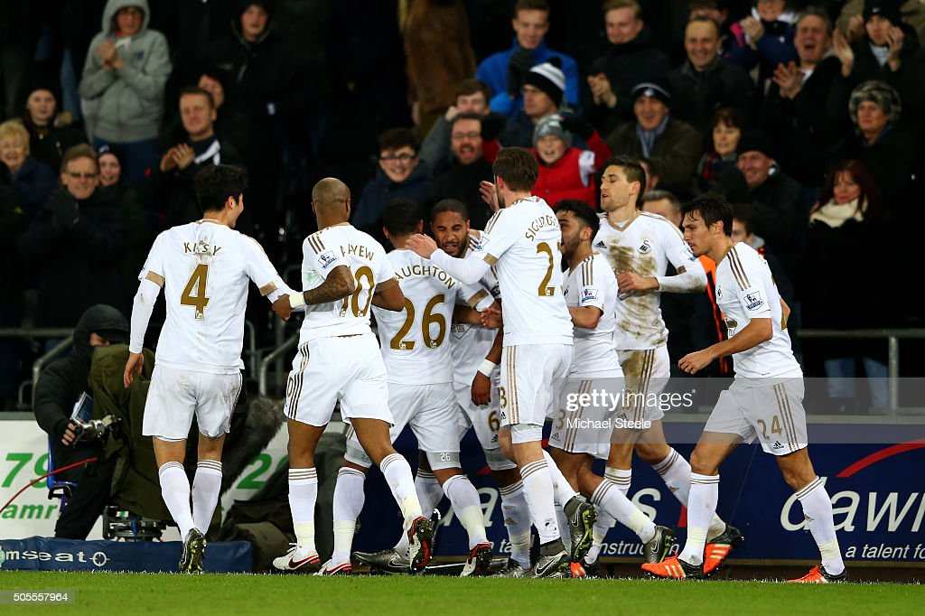 <a gi-track='captionPersonalityLinkClicked' href=/galleries/search?phrase=Ashley+Williams+-+Soccer+Player&family=editorial&specificpeople=13495389 ng-click='$event.stopPropagation()'>Ashley Williams</a> of Swansea City celebrates with team-mates after scoring the opening goal during the Barclays Premier League match between Swansea City and Watford at Liberty Stadium on January 18, 2016 in Swansea, Wales.