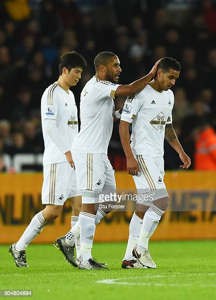Ashley Williams of Swansea City consoles Kyle Naughton of Swansea City after his red card during the Barclays Premier League match between Swansea...