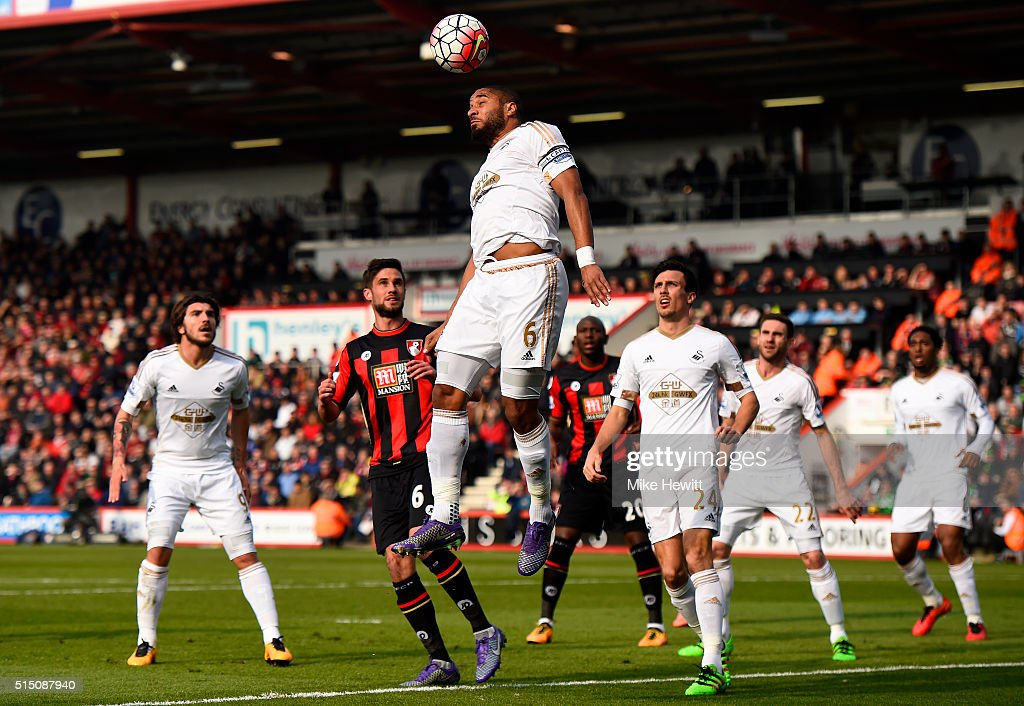 Ashley Williams of Swansea City heads the ball during the Barclays Premier League match between AFC Bournemouth and Swansea City at Vitality Stadium...