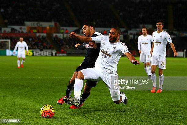 Ashley Williams of Swansea City wins the ball from Troy Deeney of Watford during the Barclays Premier League match between Swansea City and Watford...