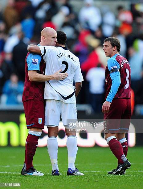 Ashley Williams of Swansea shakes hands with fellow Wales international player James Collins of Aston Villa after the Barclays Premier League match...