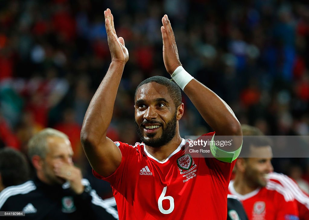 <a gi-track='captionPersonalityLinkClicked' href=/galleries/search?phrase=Ashley+Williams+-+Soccer+Player&family=editorial&specificpeople=13495389 ng-click='$event.stopPropagation()'>Ashley Williams</a> of Wales applauds the supporters after his team's 3-1 win after the UEFA EURO 2016 quarter final match between Wales and Belgium at Stade Pierre-Mauroy on July 1, 2016 in Lille, France.