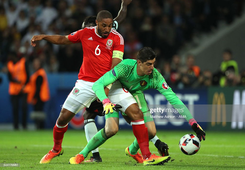 <a gi-track='captionPersonalityLinkClicked' href=/galleries/search?phrase=Ashley+Williams+-+Soccer+Player&family=editorial&specificpeople=13495389 ng-click='$event.stopPropagation()'>Ashley Williams</a> of Wales battles for the ball with <a gi-track='captionPersonalityLinkClicked' href=/galleries/search?phrase=Thibaut+Courtois&family=editorial&specificpeople=7126410 ng-click='$event.stopPropagation()'>Thibaut Courtois</a> and <a gi-track='captionPersonalityLinkClicked' href=/galleries/search?phrase=Jordan+Lukaku&family=editorial&specificpeople=8139181 ng-click='$event.stopPropagation()'>Jordan Lukaku</a> of Belgium during the UEFA Euro 2016 quarter final match between Wales and Belgium at Stade Pierre-Mauroy on July 1, 2016 in Lille, France.