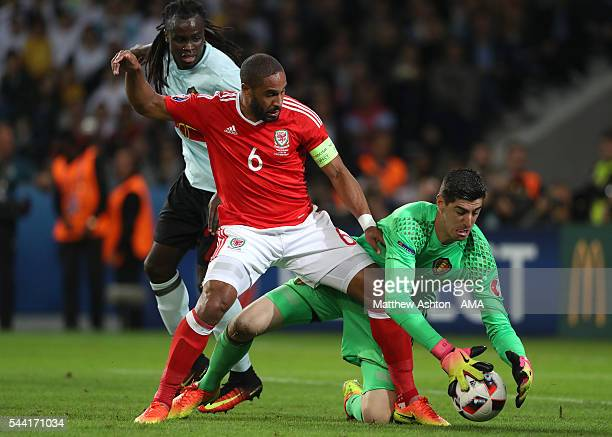 Ashley Williams of Wales battles for the ball with Thibaut Courtois and Jordan Lukaku of Belgium during the UEFA Euro 2016 quarter final match...