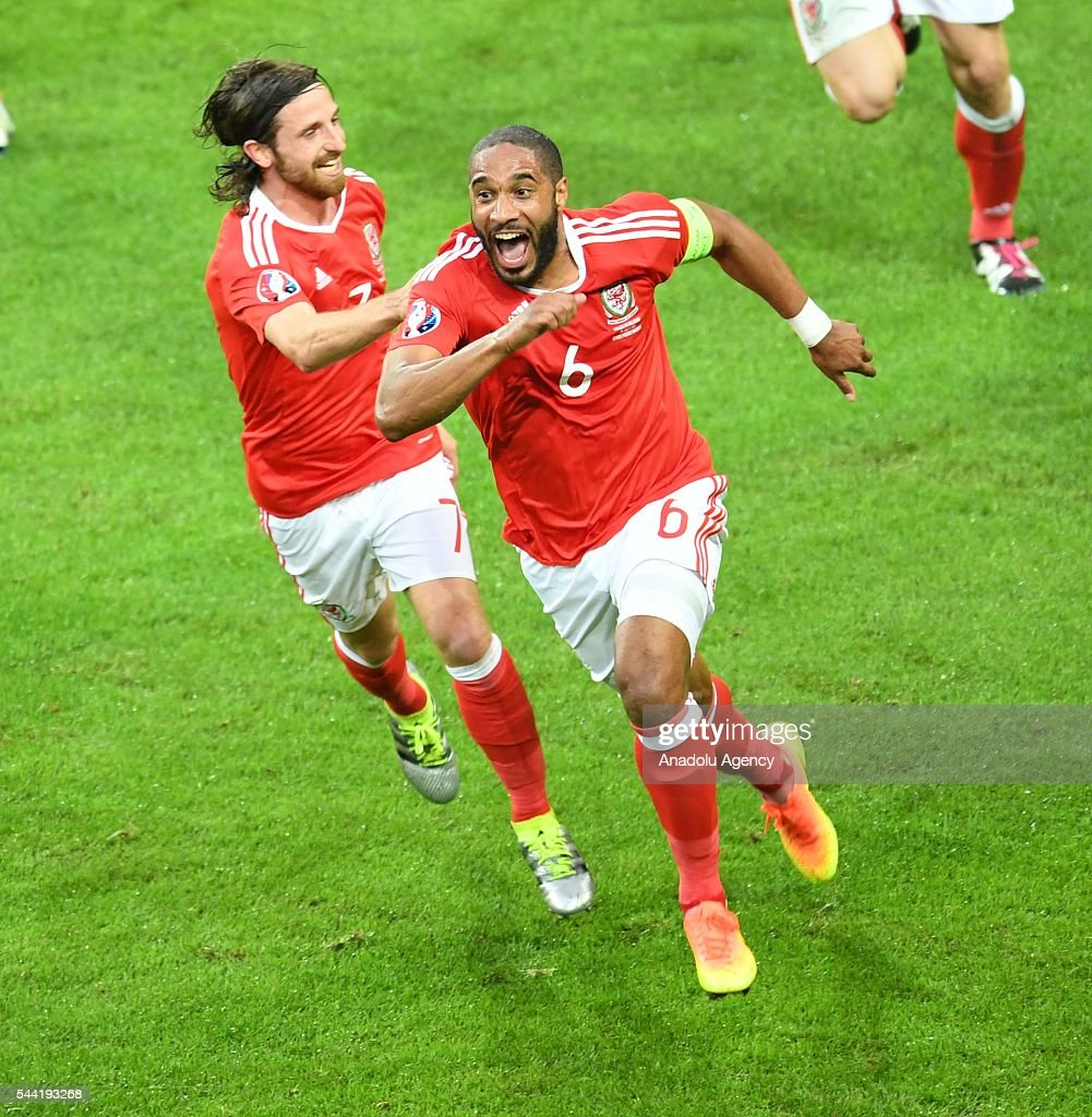 Ashley Williams (R) of Wales celebrates after scoring a goal during the Euro 2016 quarter-final football match between Wales and Belgium at the Stadium Pierre Mauroy in Lille, France on July 1, 2016.