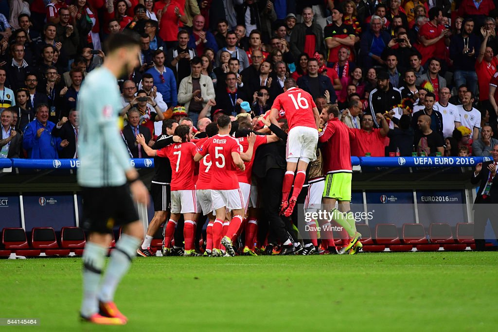 Ashley Williams of Wales (6) celebrates his goal with Wales coach Chris Coleman and team matesduring the UEFA Euro 2016 Quater Final between Wales and Belgium at Stade Pierre-Mauroy on July 1, 2016 in Lille, France.