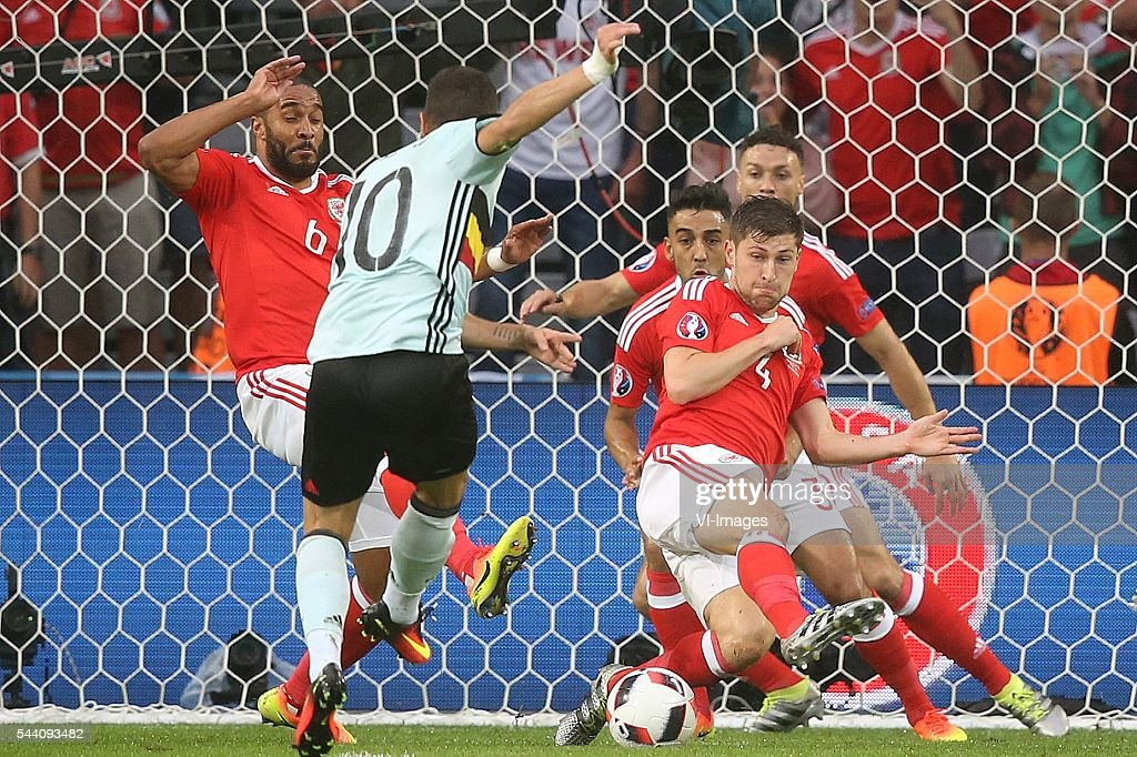 Ashley Williams of Wales, Eden Hazard of Belgium, Neil Taylor of Wales, Ben Davies of Wales, James Chester of Wales during the UEFA EURO 2016 quarter final match between Wales and Belgium on July 2, 2016 at the Stade Pierre Mauroy in Lille, France.