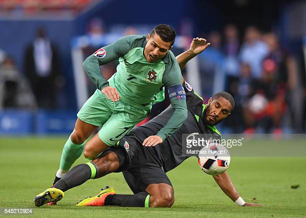 Ashley Williams of Wales tackles Cristiano Ronaldo of Portugal during the UEFA EURO 2016 semi final match between Portugal and Wales at Stade des...