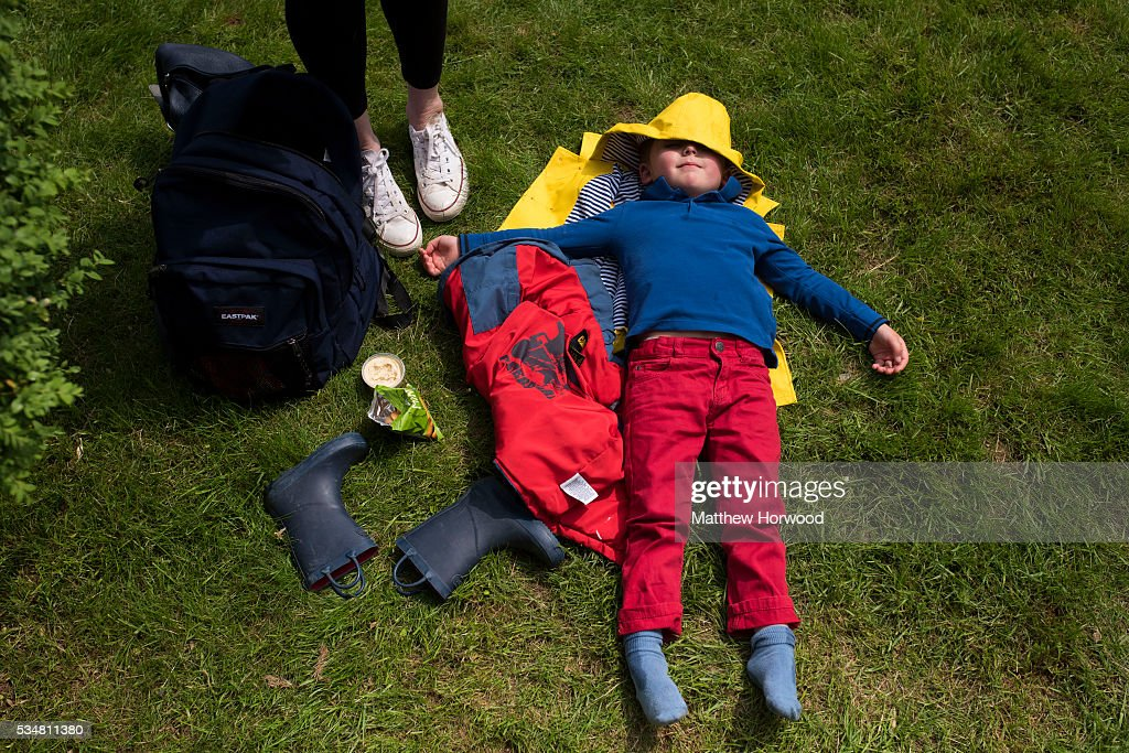 Ashley Wilson enjoys the sun during the warm summer weather in Hay-on-Wye during the 2016 Hay Festival on May 28, 2016 in Hay-on-Wye, Wales. The Hay Festival is an annual festival of literature and arts now in its 29th year.