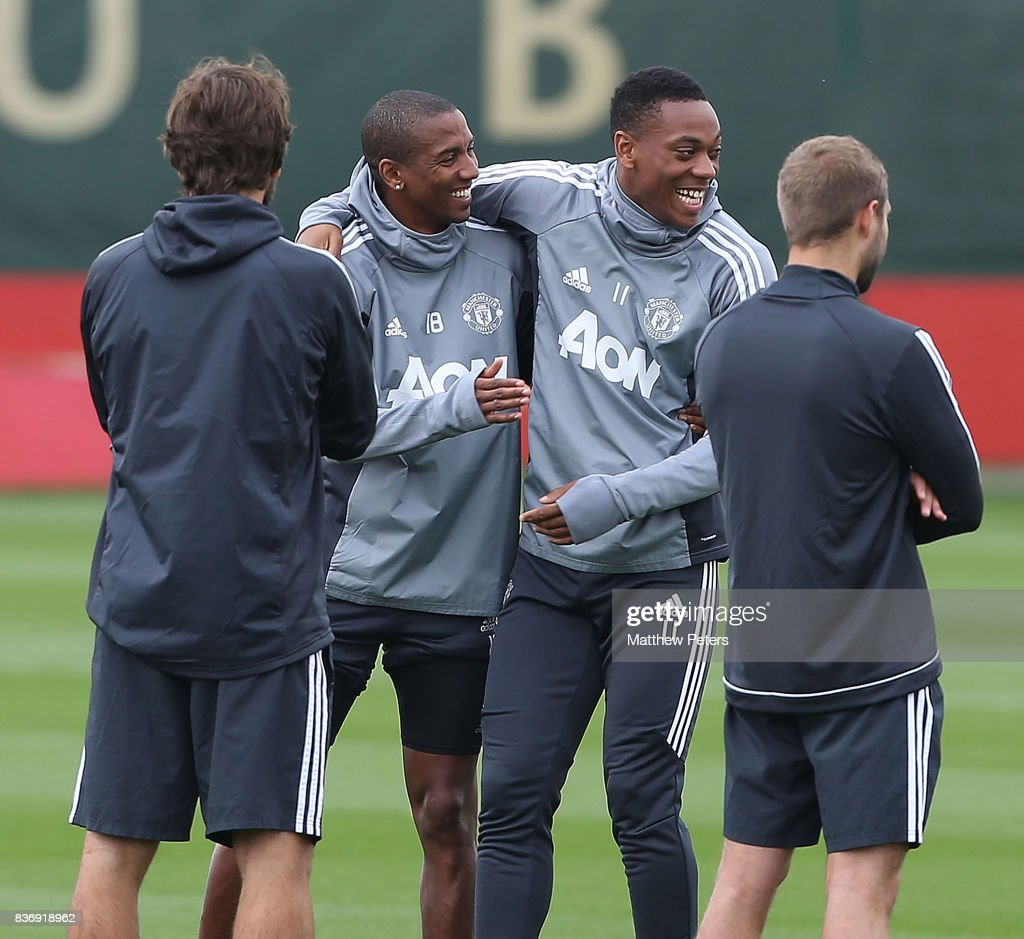 Ashley Young and Anthony Martial of Manchester United in action during a first team training session at Aon Training Complex on August 22, 2017 in Manchester, England.