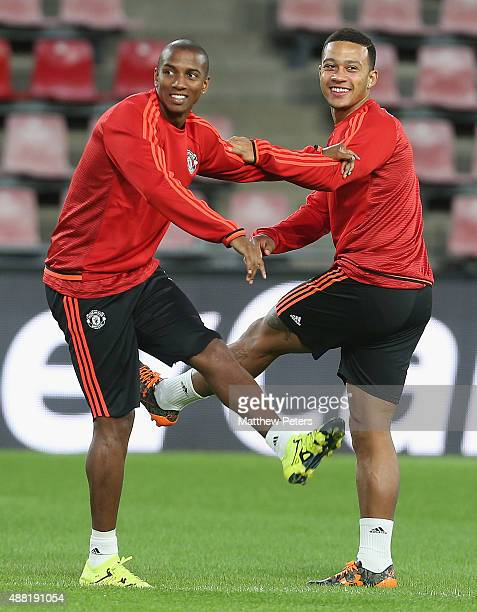 Ashley Young and Memphis Depay of Manchester United in action during a first team training session ahead of their UEFA Champions League match against...